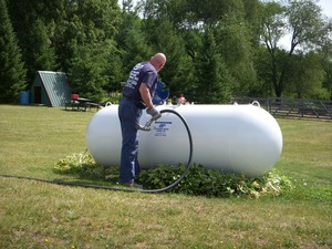 Man filling up a propane tank
